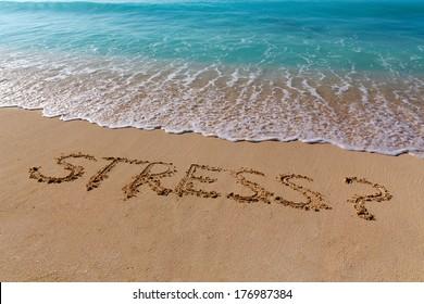 Sign STRESS on the beach with turquoise water, Zanzibar, Tanzania