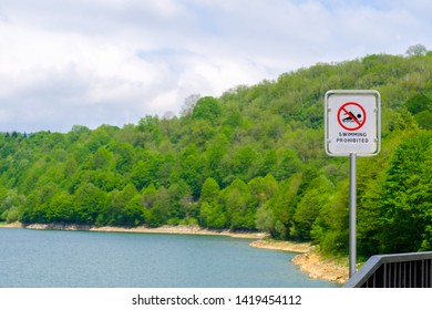 Sign swimming prohibited and icon no swimming near lake shore