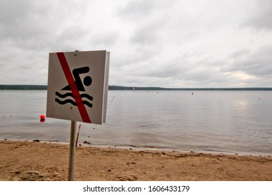 """The sign """"Swimming is prohibited"""" on the shores of Lake Seliger."""