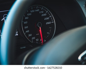 The sign and symbol on car dashboard. Car speedometer closeup. Car interior.