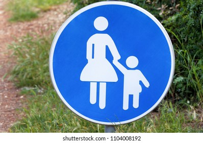 Sign or symbol for pedestrians. Warning road sign of blue sign baby take care when walk across the road symbol. Traffic sign with pedestrians in nature. Forbidden and warning signs.