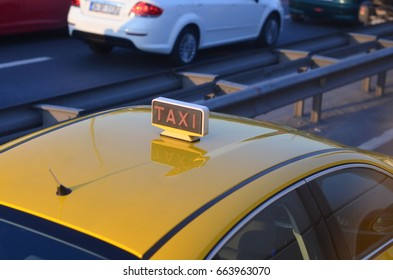 sign taxi on roof car in traffic
