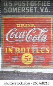 "A sign that reads for ""?Drink Coca-Cola in Bottles 5c,"" Vintage, Somerset, VA."