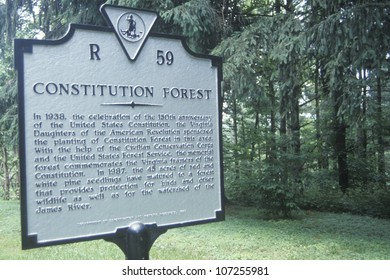 "A sign that reads ""Constitution Forest"""