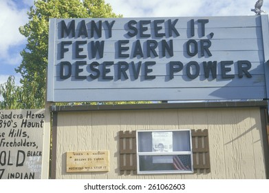 A sign that reads Many seek it, few earn or deserve power