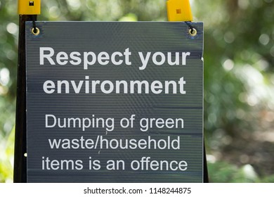 "A sign that reads ""Respect Your Environment - Dumping Of Green waste/Household Items Is An offence""."