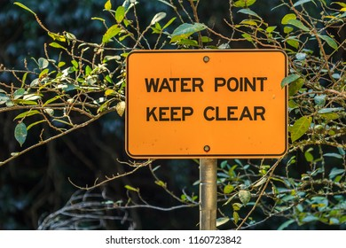 "A sign that reads ""Water Point - Keep Clear"""