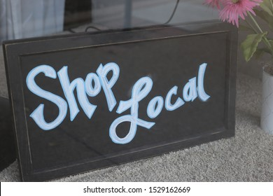 A sign that reminds people to shop local