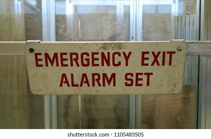 Sign that says, EMERGENCY EXIT ALARM SET.