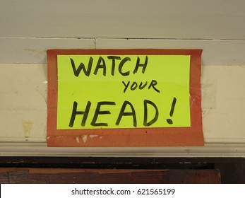 "Sign that says, ""WATCH YOUR HEAD!"""