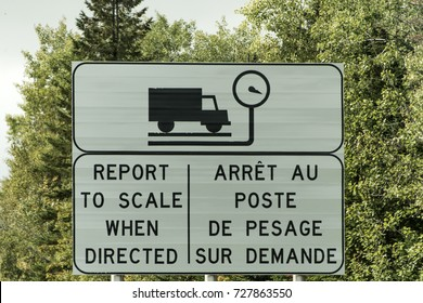 Sign Trucking Weigh Station scale report weight on highway in Quebec Canada