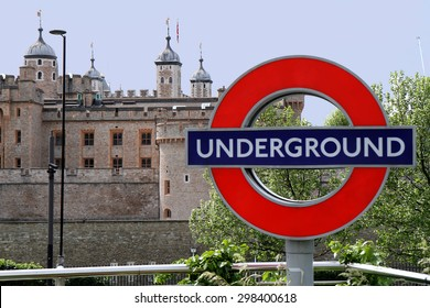 sign underground and towers of London