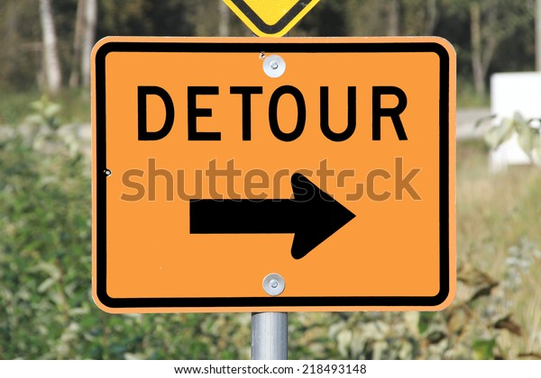 A sign used to inform motorists that they'll have to use an alternate route/Detour Sign/A sign used to inform motorists that they'll have to use an alternate route