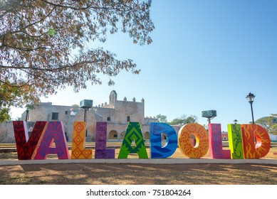 Sign for Valladolid, Mexico with the Convent of San Bernardino in the background