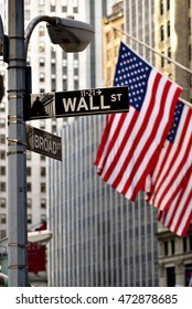 Sign for Wall Street  in New York with USA flag