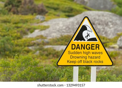 Sign warning about danger of sudden high waves on the Nova Scotia coastline, Canada