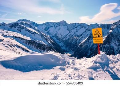 Sign warning of avalanche danger in Austrian Alps during winter ski season, Ankogel area, Austria