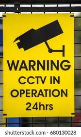 A sign warning cctv in operation 24hrs a day UK.