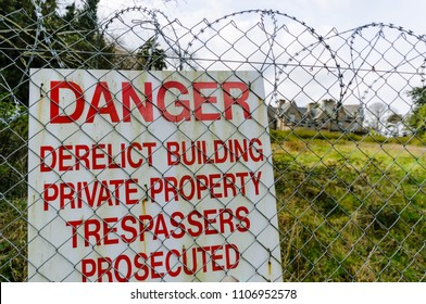 Sign warning danger of derelict building private property trespassers prosecuted