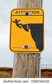 A sign warning of the danger of falling off a cliff can be found in the Madeleine Islands in Canada.
