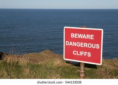 Sign warning of dangerous cliffs