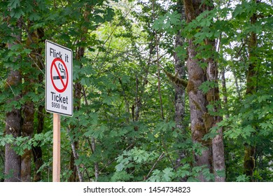Sign warning drivers not to toss cigarette butts out the window - Flick it Ticket - $950 fine