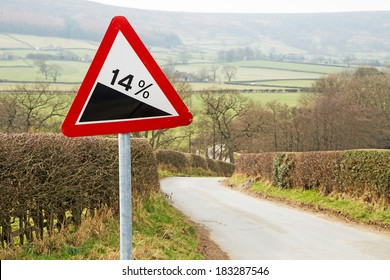 A sign warning drivers that there is a steep hill ahead.