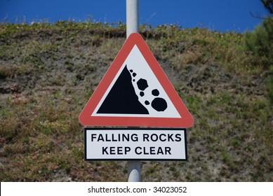 Sign warning of falling rocks under the cliffs at Folkestone in Kent, England.