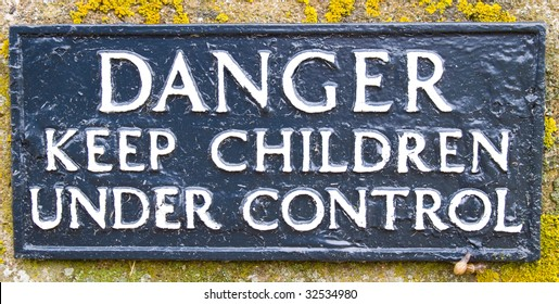 Sign warning to keep children under control because of dangerous cliffs