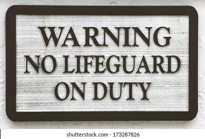"Sign: ""Warning no lifeguard on duty"""