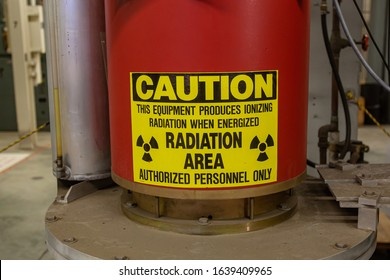 A sign warning personnel of ionizing radiation danger around klystron equipment.