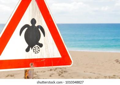 Sign warning tourists of the turtle nesting season