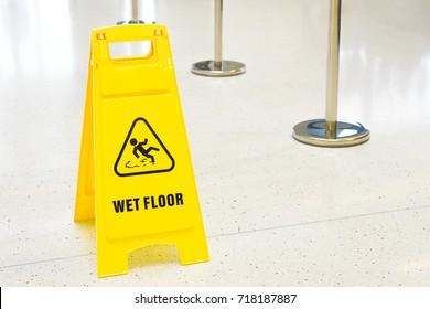 Sign warning , Yellow sign wet floor caution, wet sign on the floor