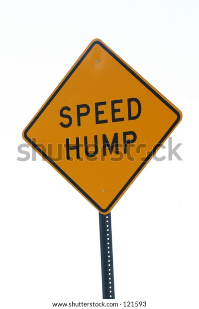 A sign warns of a speed hump ahead.
