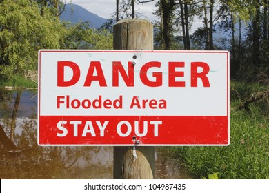 A sign warns to stay away from a flooded area/Flood Water Signage/Danger, stay out of flooded area
