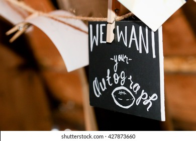 Sign at wedding reception for guest book at country or sports themed wedding.