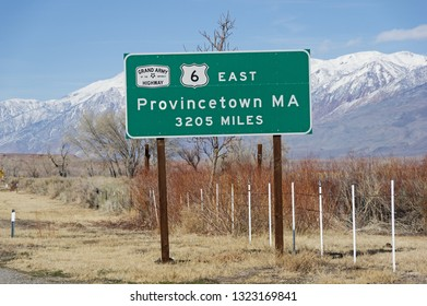 sign at the western end of US Highway 6 in Bishop California showing 3205 miles to Provincetown MA