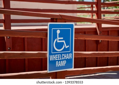 Sign with a wheelchair icon indicating a wheelchair ramp