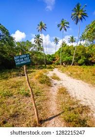 """Sign written """"Welcome to the Dutch trail"""" in Portuguese - hiking path in Ilha de Itamaraca, Brazil"""