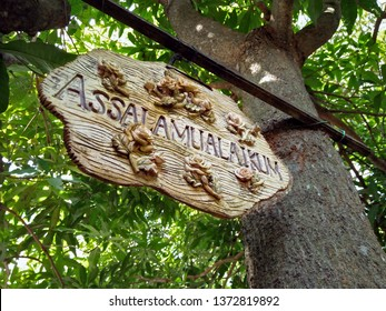 """Signage """" Assalamualaikum"""" means May Peace be Upon you. Hanging under the tree."""