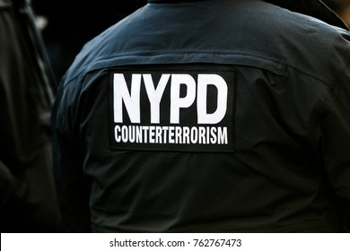 Signage on the back of the uniform of an NYPD officer from counterterrorism unit.