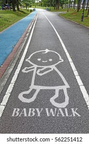 Signage of a walking baby and the precautionary message: Baby Walk.