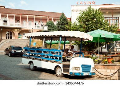 Signagi, Georgia - August 18, 2012: Tourist bus in front of Wedding palace of Sighnaghi, Kakheti region. Known as the City of Love in Georgia, with many couples visiting it to get married.