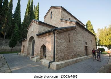 Signagi, Georgia, circa september 2018: Saint Nino Bodbe Monastery Cathedral with Garden and Paths View - Image