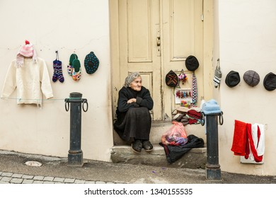 Signagi, Georgia - november 23, 2011: Local woman selling hand made wool products as a souvenir  on a  street in Signagi, Georgia