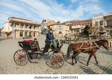 Signagi, Georgia - november 23, 2011: Wagon with a horse on a central square of picturesque Signagi town in Kakheti region, Georgia