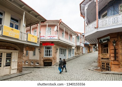 Signagi, Georgia - november 23, 2011: People walking down picturesque street of small Signagi town in Kakheti region, Georgia