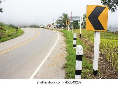 Signal curve left chevron on empty road
