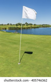 Signal flag for the hole on the golf course. Vertical photo.