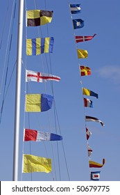 signal flags on a pole of a sailing boat
